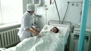 Stock Video Footage of nurse caring for a sick patient 5
