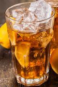 Stock Photo of lemon ice tea on wooden table