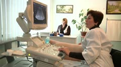 Doctor makes the patient ultrasonography Stock Footage