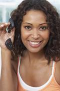 African woman holding up car keys Stock Photos