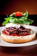 Stock Photo of italian burger with arugula and mozzarella