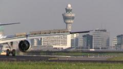 Plane taxies towards gate Stock Footage