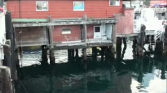Old Monterey Bay Pier Buildings Over Green Water Stock Footage