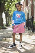 African girl standing on sidewalk - stock photo