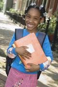 African girl holding school books Stock Photos