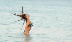 Woman flicking her hair Stock Photos