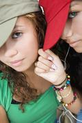 Hispanic teenaged girls wearing hats Stock Photos