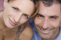 Hispanic couple touching heads Stock Photos