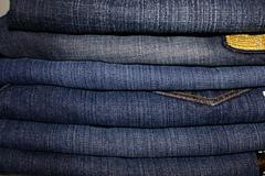 Stack of Jeans Denim Fabric Background Fashion - stock photo