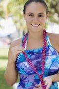 Hispanic woman wearing bathing suit - stock photo