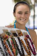 Stock Photo of Hispanic woman selling necklaces