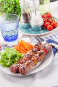 meat skewers with carrots and salad - stock photo