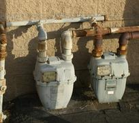 Industrial Pipes and Meters Against Wall Utilities - stock photo