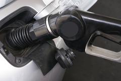 Gas Nozzle Fueling Car Petroleum Station - stock photo