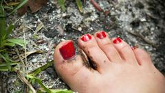 Painted nails in mud Stock Photos