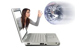 Stock Photo of attractive brunette reaching from a laptop (3)