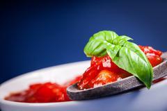 Stock Photo of fresh italian tomato sauce on blue background