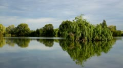 Beautiful lake with a small island Stock Footage