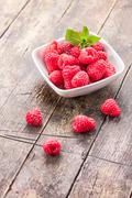 raspberries on wooden table - stock photo