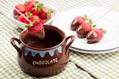 Strawberries with melted chocolate Stock Photos