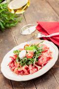bacon arugula salad - stock photo