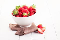 Stock Photo of strawberries inside bowl on white table