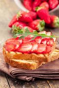 strawberry arugula sandwich - stock photo