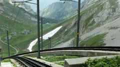 Train track coming up mountain side Stock Footage