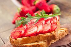 Stock Photo of strawberry arugula sandwich