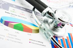 stethoscope and statistics graphic - stock photo