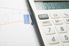 Analysis of business graphs Stock Photos