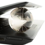 globe on a laptop keyboard - stock photo
