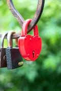 padlock as a heart on the bridge - stock photo