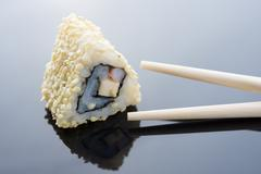 Sushi with sesame and chopsticks Stock Photos