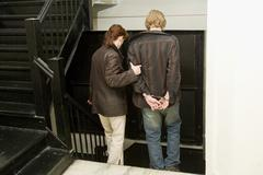 man under arrest in handcuffs 2 - stock photo