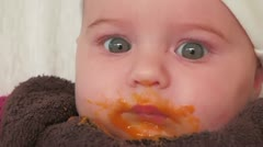 baby eats carrot for the first time - stock footage