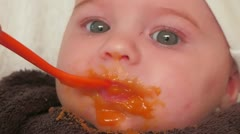 Baby eats carrot for the first time Stock Footage