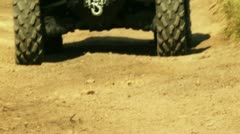 Close up view of ATV wheels in terrain. - stock footage