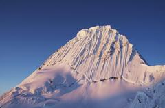 alpamayo peak on sunset in cordilleras - stock photo