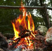 Camping fire and kettle Stock Photos