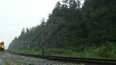 Alaska Railroad Train Leaving Whittier on Rainy Day Stock Footage