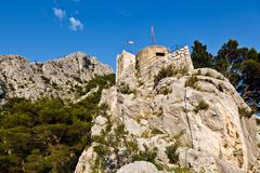 Old pirate castle in the town of omis, croatia Stock Photos