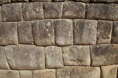 inca wall in the city macchu-picchu,peru - stock photo