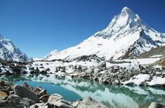 Shivling peak and beautiful lake in himalayan Stock Photos