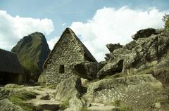 building in machu-picchu city and stone street - stock photo