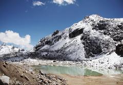 beautiful green lake in the cordilleras mountain - stock photo