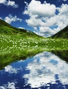 summer green grassland and lake in mountain - stock photo