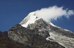 mountain peak and cloud - stock photo