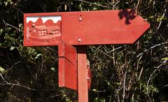 Red singboard on trail-way Stock Photos