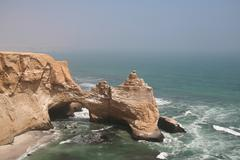 cliff in the paracas park in peru - stock photo